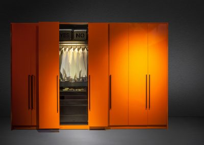 Lateral side & swing door wardrobe in high gloss tangerine laminate finish